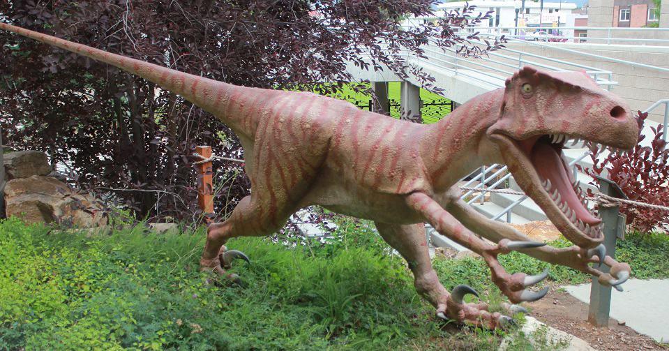 Utahraptor by John P. Alexander
